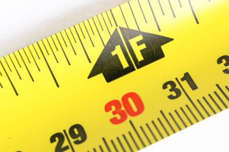 Macro of a measuring tape at the one feet marking 写真素材