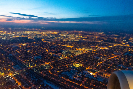 Toronto, Canada, aerial view of the city lights as a commercial plane lands in the Pearson International Airport 写真素材