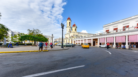 Cienfuegos, Cuba, super wide angle in a corner of the Jose Marti Park. The Cathedral of the Immaculate Conception can be seen in the distance. The area is a Unesco World Heritage Site