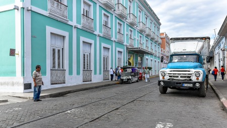 Cienfuegos, Cuba, old obsolete Russian Zyl truck driving in DClouet street. Editorial