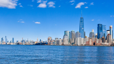 New York city, USA, urban skyline seen from a cruise in the Hudson River. The One World Trade Center is the tallest building in the image.