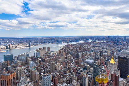 New York city, USA, urban skyline with the Hudson River crossing the urban area. High angle view
