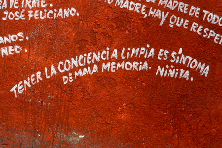 El Mejunje de Silverio indoors details of the famous place. Cuban humor phrase in Spanish and painted on the wall.