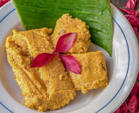 Hot tamales, decorated with with a banana leaf under. Traditional Cuban tamale filled with pork and other types of spices and condiments. like Onions and garlic. Stok Fotoğraf