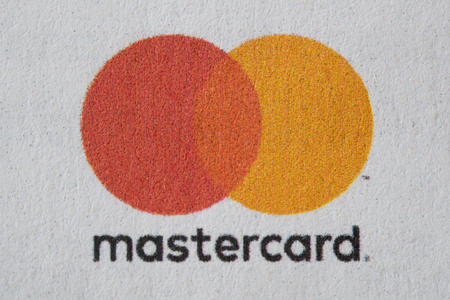 Close up of the Mastercard logo in the front view of an envelope used for sending the statements. Financial industry.