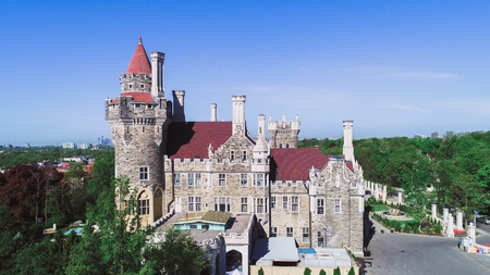 Aerial view of Casa Loma which is a gothic revival architecture castle in the Canadian city. The place is part of the Canadian National Heritage and a tourist attraction.