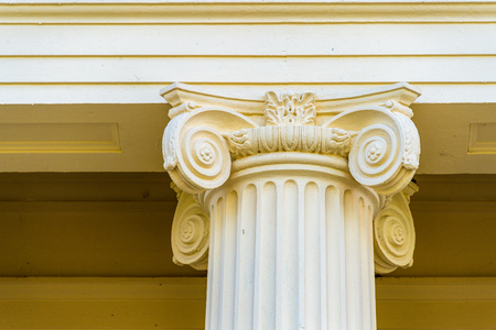 Santa Clara, Cuba, architectural detail of Jose Marti public library. Top of an Ionic column supporting a stone buildings ceiling. Editorial
