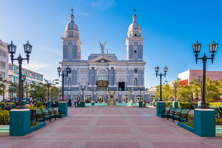 Santiago de Cuba, Catholic Cathedral Basilica of Our Lady of the Assumption. The church has two large gray towers in blue clear sky in the historic center which is a major tourist attraction. Editoriali