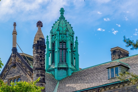 Toronto, Canada, Trinity College tower details. The downtown landmark features Jacobethan Tudor architecture Editorial