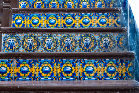 Santa Clara, Villa Clara, Cuba, colonial tiles on a stair. They have blue and yellow as main colors offering a beautiful contrast.