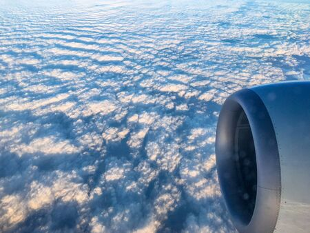 Beautiful pattern of clouds seen from inside a commercial airplane traveling over North America. The beauty of nature in unexpected places