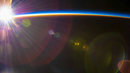 Sunset flares over the South Pacific. The beauty in nature of our planet Earth seen from the International Space Station Stock Photo