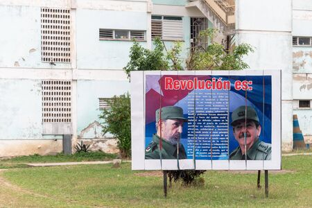 The Revolution Concept as announced by Fidel Castro. The text is seen on a city billboard located at the exit road from the Che Guevara Monument. The billboard has a photo of Fidel Castro to the lef