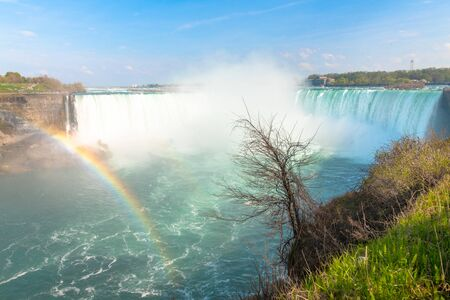 The Horseshoe Fall with a rainbow in the foreground. Wide angle view of the famous place and tourist attraction. Point of view from the Canadian side of the border 写真素材