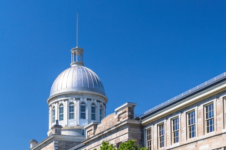 Montreal, Quebec, Canada-May 20, 2019: The Bonsecours Market in the old district of the city which is a Unesco World Heritage Site and tourist attraction. Building exterior during the daytime