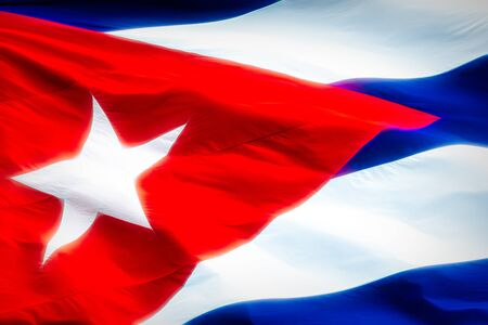 Cuban national flag close up. The patriotic symbol is waving in the wind. The color image has a glowing filter applied. 写真素材
