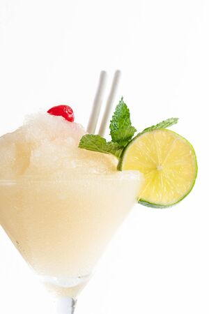 Daiquiri Frappe over a white background. The alcoholic drink is one of the Cuban traditional cocktails and its one of the most sold in the Caribbean island.