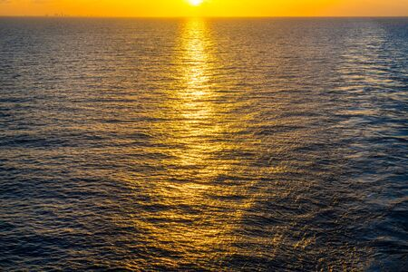 Awesome view of the sunset in the Atlantic ocean.  The vibrant color image was taken from a cruise ship going to Bahamas