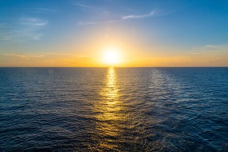 Awesome sunset in the Atlantic Ocean. Beauty in nature seen from a nautical vessel.