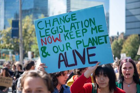 Toronto, Ontario, Canada-September 27, 2019: Sign with environmental message at the climate strike. Thousands of people gathered in Queen's Park to demand action in protecting our planet against climate change. The rally is just one of the about 85 progra