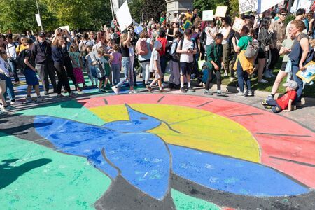 Toronto, Ontario, Canada-September 27, 2019: Thousands of people gathered in Queen's Park to demand action in protecting our planet against climate change. The rally is just one of the about 85 programmed to be held in Canada.