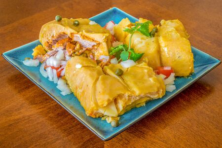 Nacatamales or naca tamales a corn dough dish traditional of Honduras and Nicaragua. The boiled dough is stuffed with different meats.
