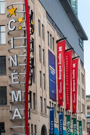 Montreal, Quebec, Canada-June 11, 2017: Sign of Cinema in the downtown district. The business is associated to the Scotiabank. The area is a a tourist attraction Publikacyjne