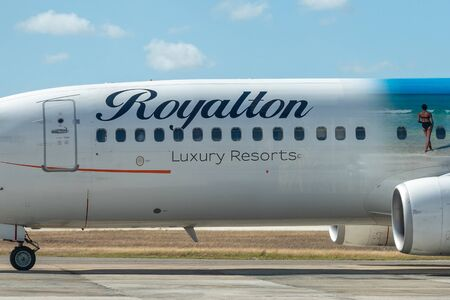 Santa Clara, Villa Clara, Cuba-March 19, 2020: Boeing commercial plane painted with the logo of Royalton Hotels. The aircraft is seen in the 'Abel Santamaria' airport Editorial