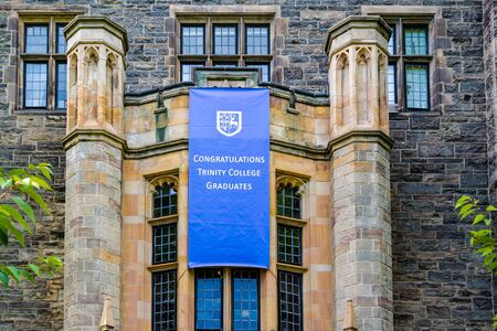 Toronto, Ontario, Canada-April 6, 2020: a blue banner congratulating the new graduates in Trinity College which is located in the downtown district