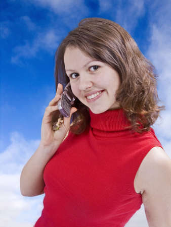 beautiful girl talking by mobile phone in the sky photo