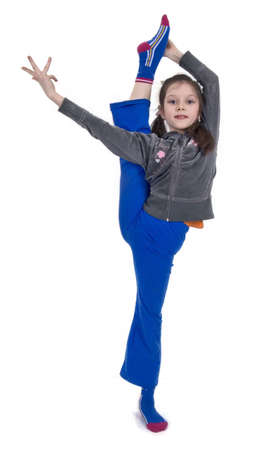 the young girl execute gymnastic exercise photo