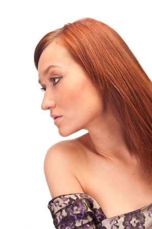 isolated profile of attractive red-haired girl with long eyelashes photo