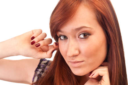 beautiful red-haired girl with red nails isolated on white