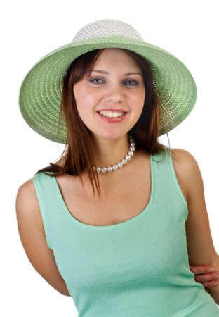 young pretty female smiling in green hat isolated on white photo