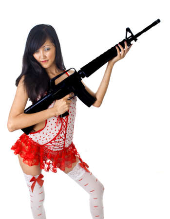 sexy asian female with rifle isolated on white photo