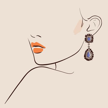 Belle femme portant des boucles d'oreilles.