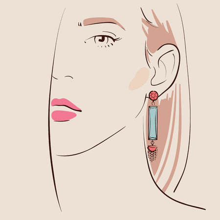 bijoux: Beautiful woman wearing earrings.
