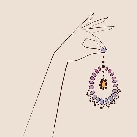 elegant woman: Beautiful woman hand holding jewelry .
