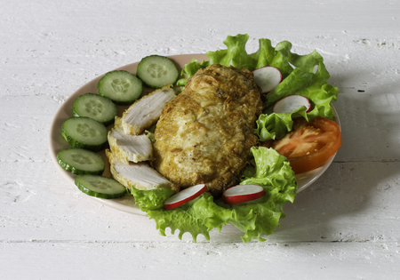 chiken: chiken meat with vegetables on a wooden table