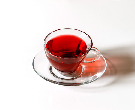 Cup of Karkadeh Red Tea isolated on a white background
