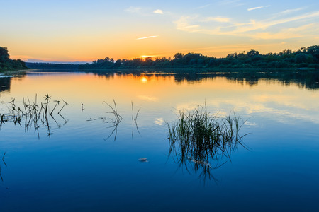 river view: Scenic view of beautiful sunset above the river at summer evening Stock Photo