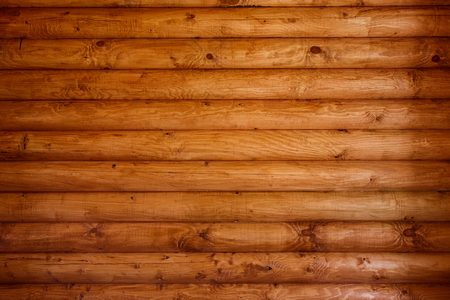 Wooden wall from logs of pine as a background texture. 版權商用圖片 - 79147359