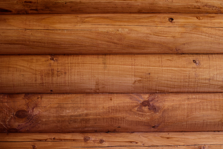 Wooden wall from logs of pine as a background texture.
