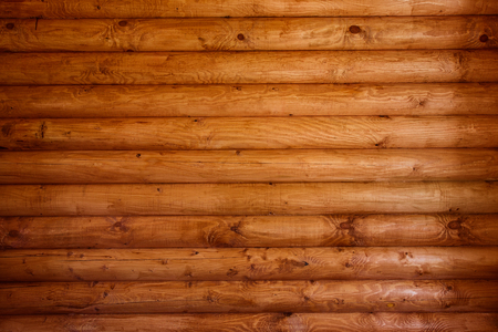 Wooden wall from logs of pine as a background texture. 版權商用圖片 - 79147503