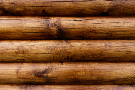 Wooden wall from logs of pine as a background texture. 版權商用圖片 - 79732388