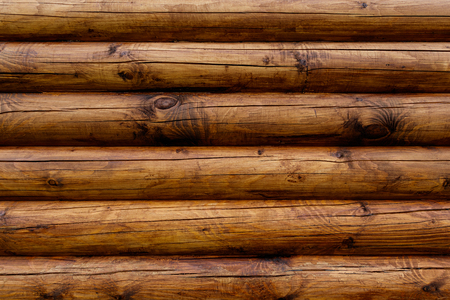 Wooden wall from logs of pine as a background texture. 版權商用圖片 - 79797396