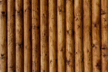 Wooden wall from logs of pine as a background texture. 版權商用圖片 - 79648528