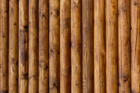 Wooden wall from logs of pine as a background texture. 版權商用圖片 - 79730885