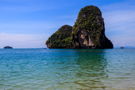 Riley beach with golden sand, karst rocks and turquoise sea on a sunny day. Province of Krabi, Thailand. Landscape.