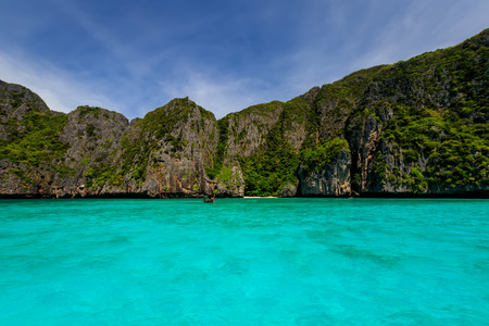 Maya Bay on the island of Phi Phi in a summer sunny day with karst rocks and turquoise Andaman sea. Landscape. Province of Krabi, Thailand.  Stock Photo